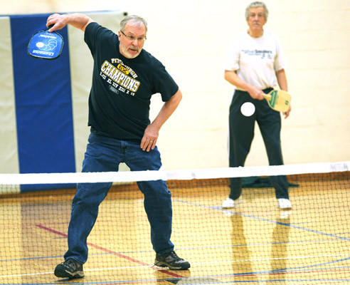 Tom Beidel, 66, of Coplay prepares to smack the ball in a game of pickleball early Friday.  A group of men gathers at the Catasauqua YMCA to play pickleball regularly.