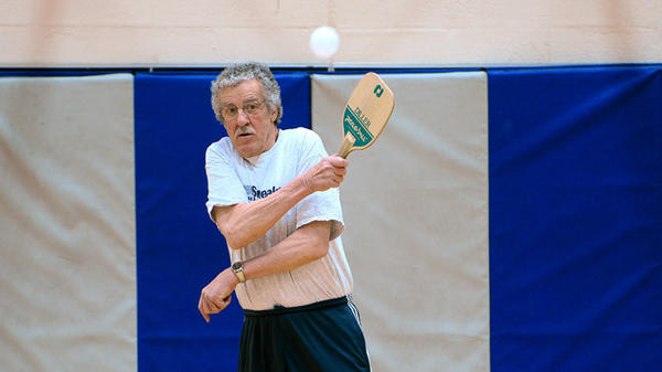 Joe Herman, 75, of Hokendauqua follows through on a shot in a game of pickleball early Friday.  A group of men gathers at the Catasauqua YMCA to play pickleball regularly.