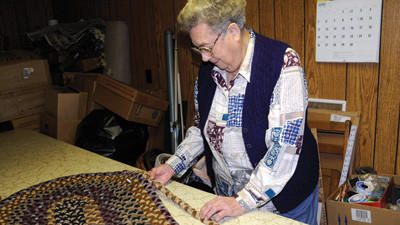 Beryl Shawley of Somerset shows the stitching of one of her handmade braided rugs.