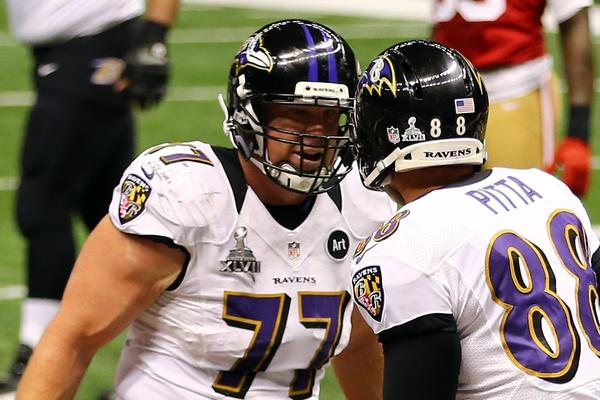 Baltimore center Matt Birk, left, celebrates a touchdown with Dennis Pitta during Super Bowl XLVII, the final game of Birk's 15-year NFL career.