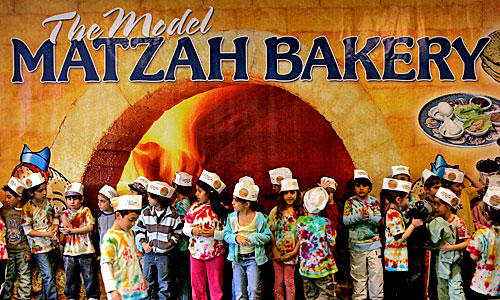 Kids learn how to make matzo before Passover each year at the Model Matzah Bakery in Westwood.