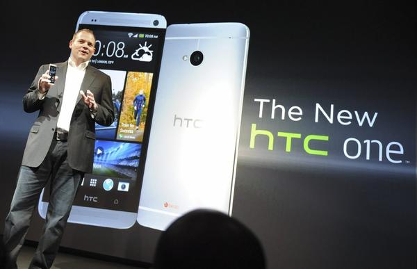 HTC President Jason Mackenzie unveils the latest HTC One smartphone in New York on Tuesday. On Friday, the Federal Trade Commission announced that HTC had agreed to settle a complaint that it failed to properly secure millions of smartphones and tablet computers against data theft.