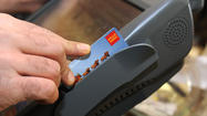 Retailers may charge fee to customers paying with credit cards