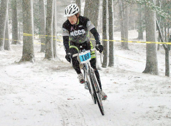 Chad Wells of the North Country Cycle Sport/Derailed cycling team makes his way through a snowy portion of the course during the CrosstheBay race in Traverse City. Wells  who along with Bo Mayfield started the NCCS Scholastic Cycling Club  is one of more than three dozen members of the growing team that competes in a number of races across the state.