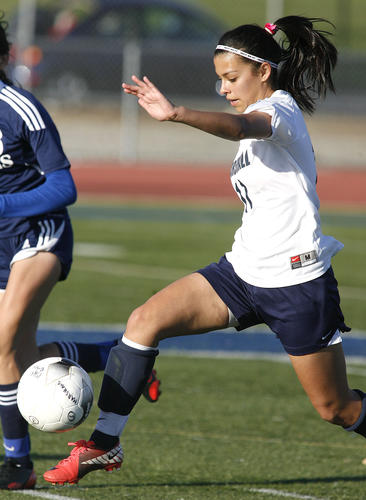 Marshall Fundamental's Erica Perez drives toward the Montebello goal in a CIF Southern Section Division VII playoff girls soccer game at Muir High School in Pasadena on Thursday, February 21, 2013.