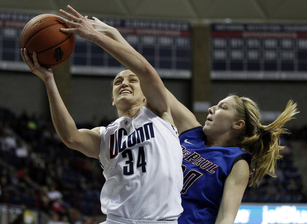UConn guard Kelly Faris shoots against DePaul Blue Demons guard/forward Megan Podkowa during the first half at Gampel Pavilion.