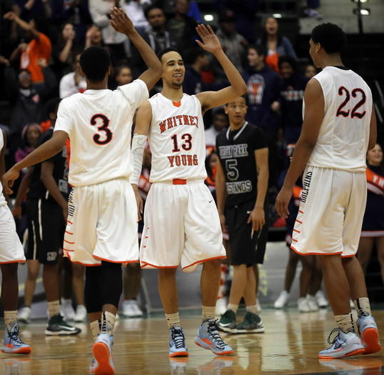 Young players celebrate after defeating Morgan Park 60-56 in overtime of the city championship Feb. 15.