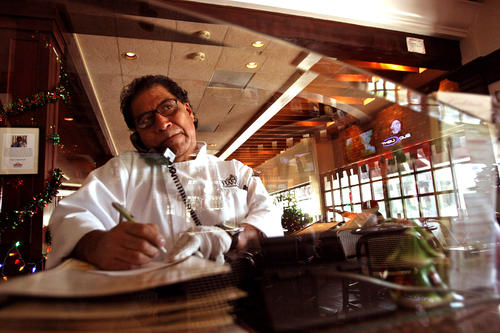 Marcelino Martinez, 61, answers the phone at the Hamburger Hamlet  he manages in Sherman Oaks. Martinez has spent 43 years at the once-prosperous chain that changed his life and the lives of many other Zapotec Indians from Oaxaca, Mexico.