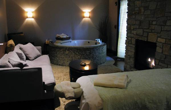 Massage suites at Aspira Spa can include a couch, whirlpool and fireplace.