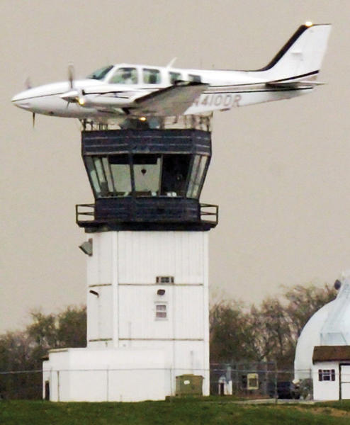A plane appears to have landed on the air traffic control tower at Hagerstown Regional Airport. The pilot was practicing a flyby.
