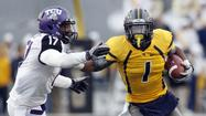 "<a>West Virginia</a> star wide receiver <a href=""http://data.baltimoresun.com/maryland-recruiting/highschool/?p=1190"">Tavon Austin</a> once embarrassed a proud Oklahoma defense with his unique brand of elusiveness."