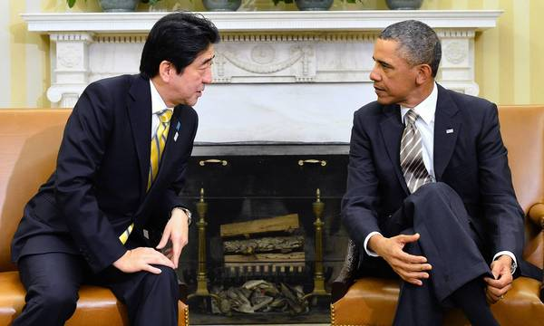 President Obama, right, converses with Japanese Prime Minister Shinzo Abe at the White House.
