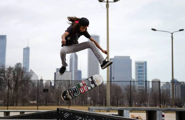 Andres Prado, 15, jumps his skateboard at a temporary skate park in Grant Park on Monday.