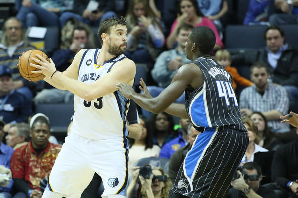 Memphis Grizzlies center Marc Gasol (33) drives against Orlando Magic forward Andrew Nicholson (44) during the first half at the FedEx Forum.