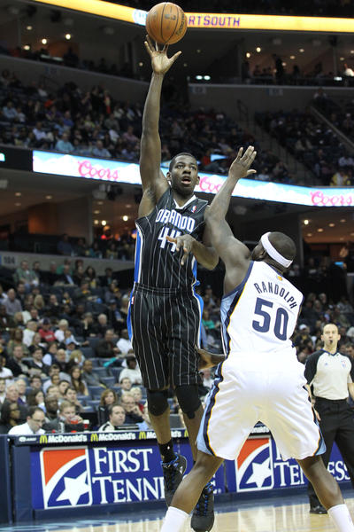 Orlando Magic forward Andrew Nicholson (44) shoots over Memphis Grizzlies forward Zach Randolph (50) during the first half at the FedEx Forum.