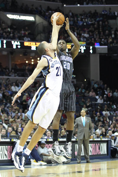 Orlando Magic forward DeQuan Jones (20) shoots over Memphis Grizzlies forward Tayshaun Prince (21) during the first half at the FedEx Forum.
