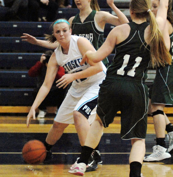 Petoskey senior guard-forward Kelsey Ance (left) finished with a game-high 24 points Friday as the Northmen defeated Alpena, 59-25, in a Big North Conference contest at the Petoskey High School gym. The Northmen finish the regular season at 17-2 overall, 11-1 league and clinched the Big North Conference title