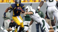 West Virginia wide receiver Tavon Austin's game is defined by his trademark elusiveness, making defenders fall down with his repertoire of moves.