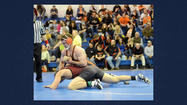 WINDBER — The District 5 Class AA Wrestling Tournament got under way Friday night at Windber Area High School.
