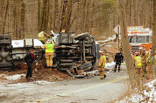 Firefighters and police begin the cleanup Friday afternoon of the crash that killed a propane truck driver on Gun Club Road in Lynn Township.