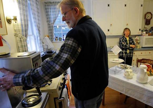 Ada May Roberts (R) and her husband Donald prepare breakfast for the guests at their Amelia Payson House Bed and Breakfast in Salem, Massachusetts