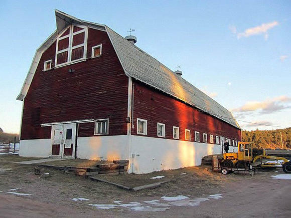 Old red barn at center of debate