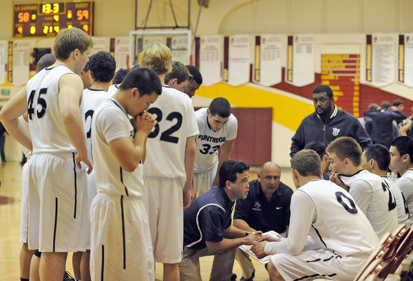 Flintridge Prep's head coach Garrett Ohara talks to the team during a time out in the fourth quarter of their CIF Southern Section Division V-AA semifinal boys' basketball playoff game against Mission Prep at La Canada High School on Friday, Feb. 22, 2013.