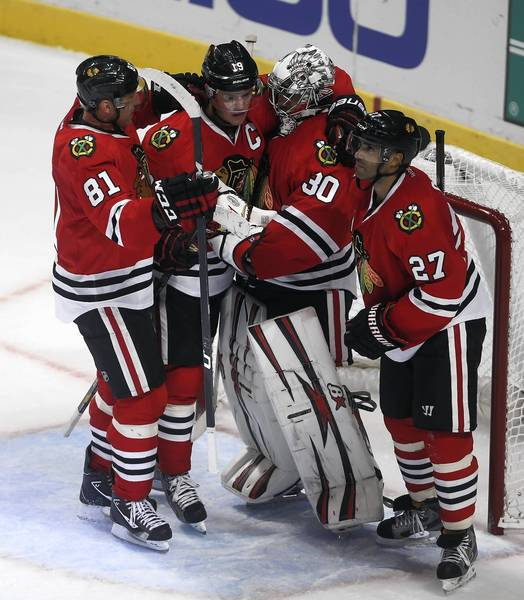 Marian Hossa, Jonathan Toews, Ray Emery and Johnny Oduya celebrate the win.