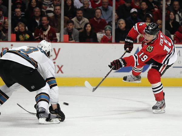 Blackhawks center Jonathan Toews shoots against Sharks defenseman Douglas Murray.