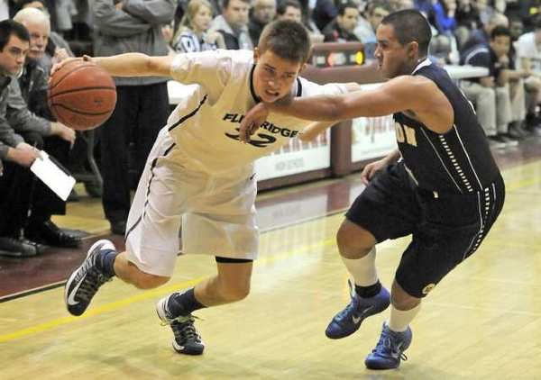 Flintridge Prep junior guard Robert Cartwright, left, finished four of 17 from the field for 11 points.