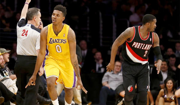 Kobe Bryant breaks to the hoop past defender Meyers Leonard during the first half of the Lakers' matchup with the Portland Trail Blazers on Friday.