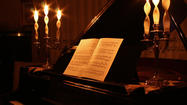 "The name ""Concertos by Candlelight"" might conjure up subdued sounds watched by shadowy figures in the flickering illumination."