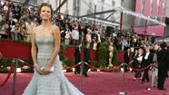 The Academy Awards are the biggest fashion runway on the planet. When Jennifer Lawrence, Anne Hathaway, Amanda Seyfried and other stars step out onto the red carpet Sunday, they will be primed to talk as much about what and who they are wearing as about the films that got them there.