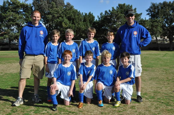 The Corona del Mar Silver All-Stars, are back row, from left:  Coach Gordon Kennedy, Austin Floriani, Colin Spruce, Jack Johnston, Christopher Dolak and Coach Mike Plumb.  Front row, from left: Matthew Neiger, Iain Kennedy, Ryan Chinnici and Ian Schoenbaum.  Not in photo:  Liam Raffay.
