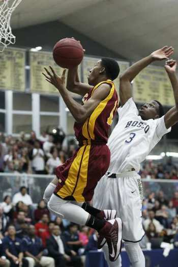 Ocean View's Kendall Small goes up for a shot against St. John Bosco's Brian Nebo during a CIF Southern Section Division 3A boys' basketball semifinal game on Friday.