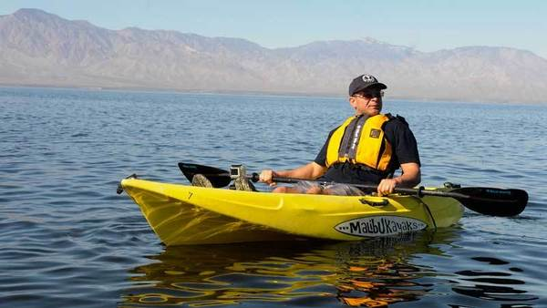 Perez takes a kayak tour before the hearing Friday morning at the Salton Sea.