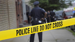 Man and woman shot in separate Baltimore incidents