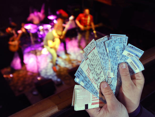 A stack of old Ticketmaster tickets pictured at The 8x10, a Federal Hill music venue.