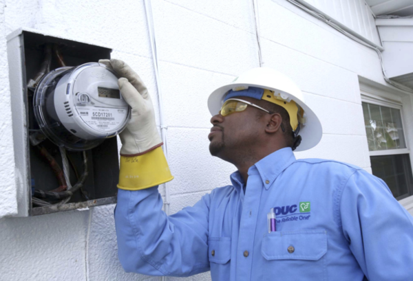 Orlando Utilities worker Wardell Peterson installs a new smart meter in south Orlando.