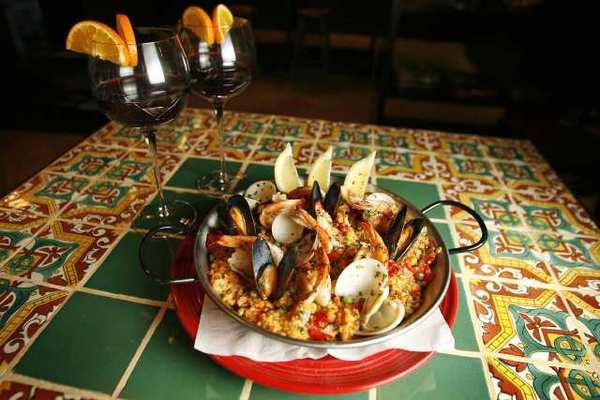 Paella blends well with the sophisticated interior at Casa Cordoba, a Spanish restaurant in Montrose.