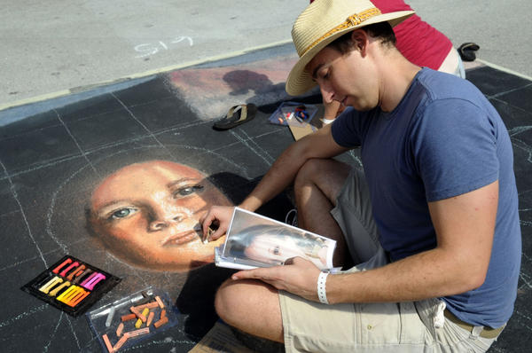 Nate Baranowski of Tampa works on a portrait at the 19th annual Lake Worth Street Painting Festival Saturday.  More than 400 artists are painting the streets downtown with their own original art and recreations of masterpieces.  The festival continues Sunday on Lake and Lucerne Avenues where there is also live music and food.