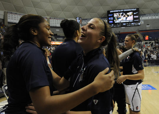 UConn senior Caroline Dody, center, is hugged after being honored on Senior Night before the Huskies faced Seton Hall at Gampel Pavillion in Storrs Saturday. At right , also honored is senior Heather Buck.