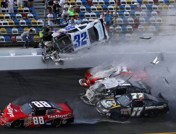 Kyle Larson's car disinegrates against the safety fence at that finish line in the final seconds of the Nationwide 300 race at Daytona International Speedway.