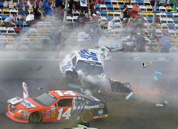 A spectacular crash involving the car of Kyle Larson (32) happens on the last lap of the DRIVE4COPD 300 Nationwide Series race at Daytona International Speedway