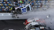 DAYTONA BEACH – At least five people in the stands were reportedly injured at Daytona International Speedway on Saturday when a multi-car accident sent wreckage into the safety fence in front of the grandstand.