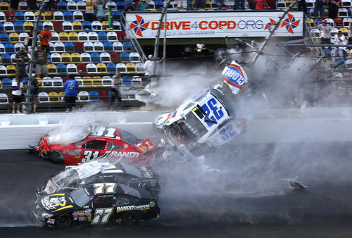 Kyle Larson's car desinegrates into the catch fench at the finish line in the final seconds of the Nationwide 300 race at Daytona International Speedway