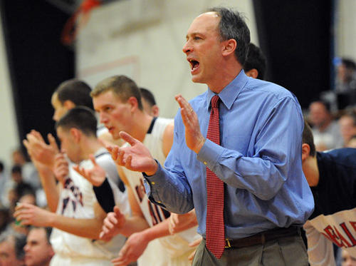DeSales University's head basketball coach Scott Coval cheers on his team along the sideline against Delaware Valley College during their  Freedom Conference championship game at Billera Hall Saturday afternoon.