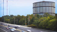 For about eight decades, the 258-foot Melvale Gas Holder has towered above northern Baltimore. In seven seconds Sunday morning, the storage tank will be brought to the ground.