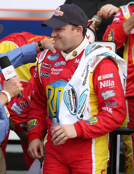 Tony Stewart is subdued in Victory Lane after winning the DRIVE4COPD 300 Nationwide Series race at Daytona International Speedway on Saturday