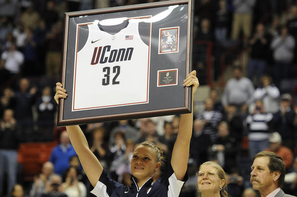 UConn's Heather Buck raises her framed jersey while being honored on Senior Day Saturday before the game against Seton Hall at Gampel Pavilion.